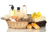 Composition of cosmetic bottles and soap in basket, isolated on white — Stock Photo