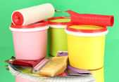 Set for painting: paint pots, brushes, paint-roller, palette of colors on green background — Stock Photo