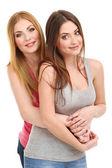 Twee vriendinnen knuffelen geïsoleerd op wit — Stockfoto