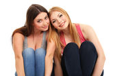 Two girl friends smiling isolated on white — Stock Photo