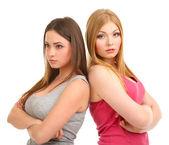 Två väninnor gräl isolerad på vit — Stockfoto