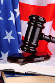 Judge gavel and books on american flag background — Stok fotoğraf
