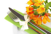 Festive dining table setting with flowers isolated on white — Stock Photo