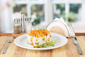 Risotto on plate on wooden table on bright background — Foto de Stock