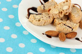 Aromatic cookies cantuccini on plate on blue tablecloth close-up — Stock Photo