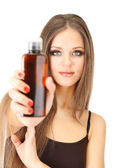 Woman with long hair holding bottle of shampoo, isolated on white — Stock Photo