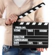 Movie production clapper board in hands isolated on white - Stock Photo