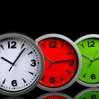 Round office clocks on black background — Foto Stock