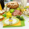 Serving Easter table with tasty dishes on room background — Stok fotoğraf