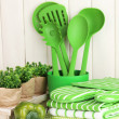 Kitchen settings: utensil, potholders, towels and else on wooden table — Stock Photo #23003100