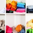 Clothing scattered on shelves - Stock fotografie