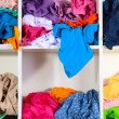 Clothing scattered on shelves - Stock Photo