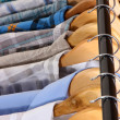 Stock Photo: Men's shirts on hangers