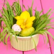 Royalty-Free Stock Photo: Easter eggs in bowl with grass on pink wooden table close up
