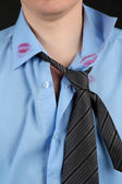 Lipstick kiss on shirt collar of man, isolated on black — Stock Photo