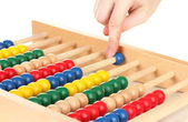 Accountant counting on abacus, isolated on white — Stock Photo