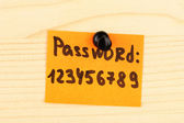 Sticker-reminder with most popular password, on wooden background — Stock Photo