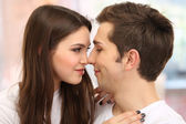 Young couple on bright background — Stock Photo
