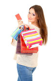 Woman with bags isolated on white — Stock Photo