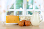 Dairy products and eggs on table in kitchen — Stock Photo