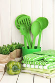 Kitchen settings: utensil, potholders, towels and else on wooden table — Stockfoto