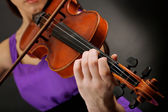 Beautiful young girl with violin on grey background — Stock Photo