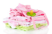 Pile of baby clothes isolated on white — Stock Photo