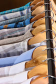 Men's shirts on hangers — Stock Photo