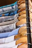 Men's shirts on hangers — Stock Photo