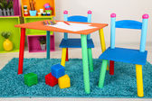 Small and colorful table and chairs for little kids — Stock Photo