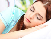Beautiful young woman sleeping in bed — Stock Photo