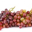 Delicious ripe grapes isolated on white — Stock Photo