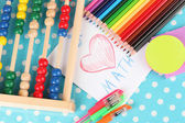 Toy abacus, note paper, pencils on bright background — Stock Photo