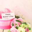 Ranunculus (persian buttercups) and gift for mothers day, on white wooden background — Stock Photo #23031358
