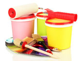 Set for painting: paint pots, brushes, paint-roller, palette of colors isolated on white — Zdjęcie stockowe