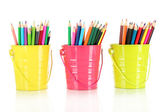 Colorful pencils in three pails isolated on white — Stock Photo