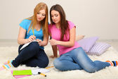 Two girl friends study on room — Stock Photo