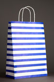 Striped bag on gray background — Stock Photo