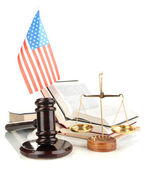 Wooden gavel, golden scales of justice, books and American flag isolated on white — Stock Photo
