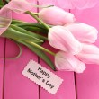 Beautiful bouquet of tulips for Mother's Day on pink wooden background — Stock Photo #23072136