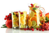 Transparent jar and glasses with exotic fruits, isolated on white — Stock Photo