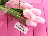Beautiful bouquet of tulips for Mother's Day on pink wooden background — Stok fotoğraf
