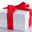 Gift box with red ribbon, isolated on white — Stock Photo #23109880