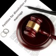 Divorce decree and wooden gavel on black background — Stock Photo