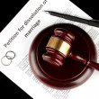 Stock Photo: Divorce decree and wooden gavel on black background