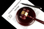 Divorce decree and wooden gavel on black background — 图库照片