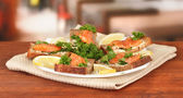 Salmon sandwich on plate,on bright background — Stock Photo