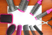 Comb brushes, hairdryer and cutting shears,on wooden background — Foto Stock