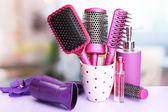 Hair brushes, hairdryer and cosmetic bottles in beauty salo — Stock Photo