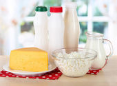 Dairy products on napkin on table in kitchen — Stock Photo